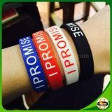 La fabbrica direttamente ha personalizzato il braccialetto stampato del silicone di colore di marchio