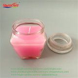 수정같은 뚜껑을%s 가진 분홍색 젖빛 유리 홀더 냄새가 좋은 초
