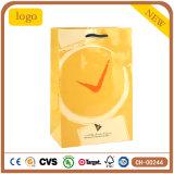 Sac de papier d'horloge de configuration d'art de cadeau enduit jaune de mode