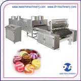 Os doces do caramelo moldam os doces duros desobstruídos da fruta que fazem a máquina