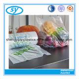 Ясные полиэтиленовые пакеты упаковки еды на крене