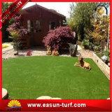 Precios artificiales de la hierba del césped del jardín sintetizado falso ULTRAVIOLETA anti