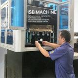 Una máquina de cristal del moldeo por insuflación de aire comprimido de Champán del vino automático del paso de progresión