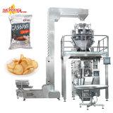 A banana automática das microplaquetas de batata dos petiscos das microplaquetas lasca a máquina de empacotamento do alimento