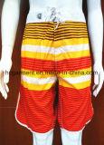 Os Shorts nadadores da placa do poliéster do desgaste secam rapidamente para o homem/mulheres