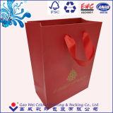 Bolso de papel de lujo de encargo del regalo de las compras con la venta al por mayor de la impresión de la insignia