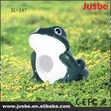 Im Freienhintergrund-Musik-Rasen-Lautsprecher der Karikatur-2017 Frosch versteckter