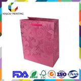 Sacchetto di carta grazioso impermeabile rivestito delle signore con il reticolo di fiore