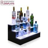 Cremagliera di visualizzazione acrilica del vino del bello di disegno del contatore basamento della bottiglia da birra con l'indicatore luminoso del LED