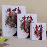 O baixo custo feito sob encomenda Kraft branco Craft o saco de papel do Feliz Natal para o presente