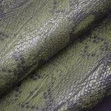 La grande pelle di serpente imita il cuoio del Faux dell'unità di elaborazione per i pattini dei sacchetti