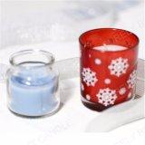Candela di vetro del vaso per natale con neve