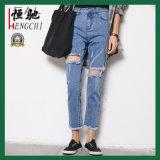 Jeans scarni del denim delle donne di stirata prefabbricata di modo