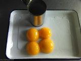 Alimentos enlatados Conservas de pêssego amarelo OEM