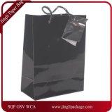 Sac lustré noir de cadeau de papier enduit, sac à provisions de papier lustré, sac de cadeau, sac de papier de cadeau, sac à provisions de papier avec le logo d'impression