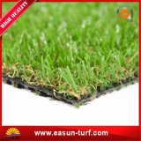 Césped del sintético de la hierba de la decoración del paisaje que cultiva un huerto