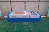 Cheap pequeño escritorio tipo 3020 40-50 W grabadora láser de CO2 de madera MDF acrílico de plástico de la madera contrachapada de grabado de cuero