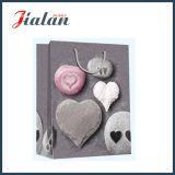 Sac de papier de achat estampé par 4c en forme de coeur en gros de cadeau de pierre