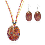 Комплект серьги и ожерелья падения Богемии геометрии раковины глаза пера павлина