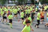 Marathon respirable en gros de sports exécutant le T-shirt à séchage rapide de Wicking