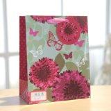 Sac doux idyllique de cadeau d'achats de sucrerie de fleurs et de guindineaux de papier enduit