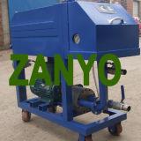 Dispositivo de filtración de aceite a presión de placa