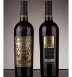 A folha quente da transferência térmica de folha de carimbo pressionou no frasco de vinho