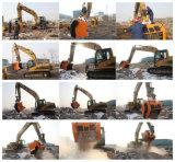 Il materiale dell'escavatore ricicla la benna del frantoio che schiaccia la benna