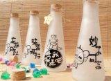 Botella vacía del jugo, botella de cristal, envase de cristal de consumición