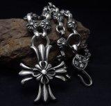 Collier de 30 morceaux en acier titane avec pendentif croisé