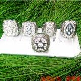 De Ringen van het Kampioenschap van de Replica van de Cowboys van Dallas die met het Verschepen van de Daling worden geplaatst