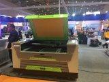モーターを備えられたup-Downのワークテーブル(XE1390A)が付いているレーザーの彫版及び打抜き機