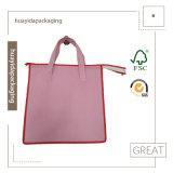 عالة يطبع ترويجيّ حمل قطر حقائب