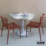 Salle de Cafe Pierre artificielle des tables et chaises