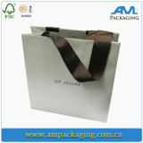 Portador del regalo que empaqueta las bolsas de papel grandes con la maneta de la impresión en color y de la cuerda