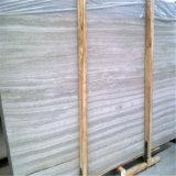 El mármol sin procesar bloquea el mármol de madera gris del grano