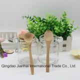 Бутылка пудинга одиночного уха стеклянная для того чтобы установить ложку с деревянными крышками