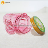 Tarro de masón formado cacto del vidrio de consumición con la tapa y la paja