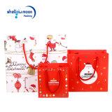 크리스마스 면 손잡이를 가진 빨간 백색 종이 봉지 선물 부대