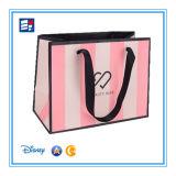 O saco de compra do papel de arte para o presente de empacotamento com costume lida