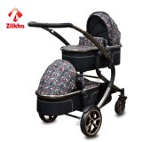 Carrinho de criança de bebê com frame e o Carrycot pequeno do assento e o pequeno