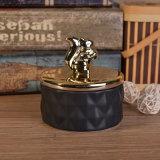 Vaso di ceramica lustrato nero opaco della candela con i coperchi dell'animale dell'oro