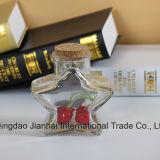 Estrella en cinco puntos de dos tallas que desea la botella de cristal