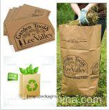 葉の屑の屋外のクラフト紙袋の葉および芝生の屑の屑の紙袋