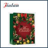 Cadeaux estampés de Joyeux Noël de papier enduit de promotion bourrant des sacs à provisions