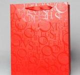 Saco de presente de papel de compras impresso com estampagem a quente ou acabamento de alta luminosidade