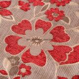赤いシュニールのソファーおよび織布