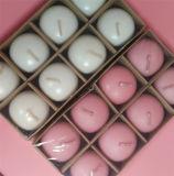 Sich hin- und herbewegende Kerze im Geschenk-Set und rosafarbene Kerze für Dekoration