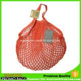 赤く再使用可能な編まれたストリング綿のショッピング・バッグ