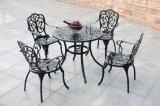 Vector y sillas del metal de los muebles del jardín